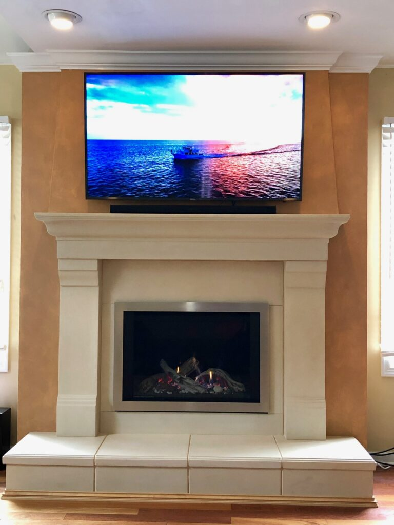 Gas Fireplace with White Mantel and TV