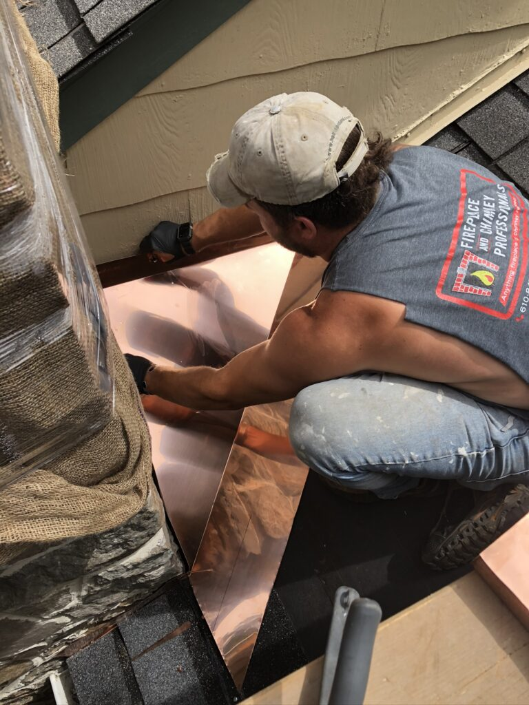 installation of copper roof flashing to prevent water leaks