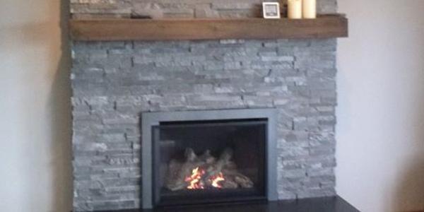 fireplace surround stone facade rustic wood mantel shelf